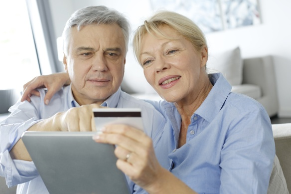 Senior couple doing shopping on internet